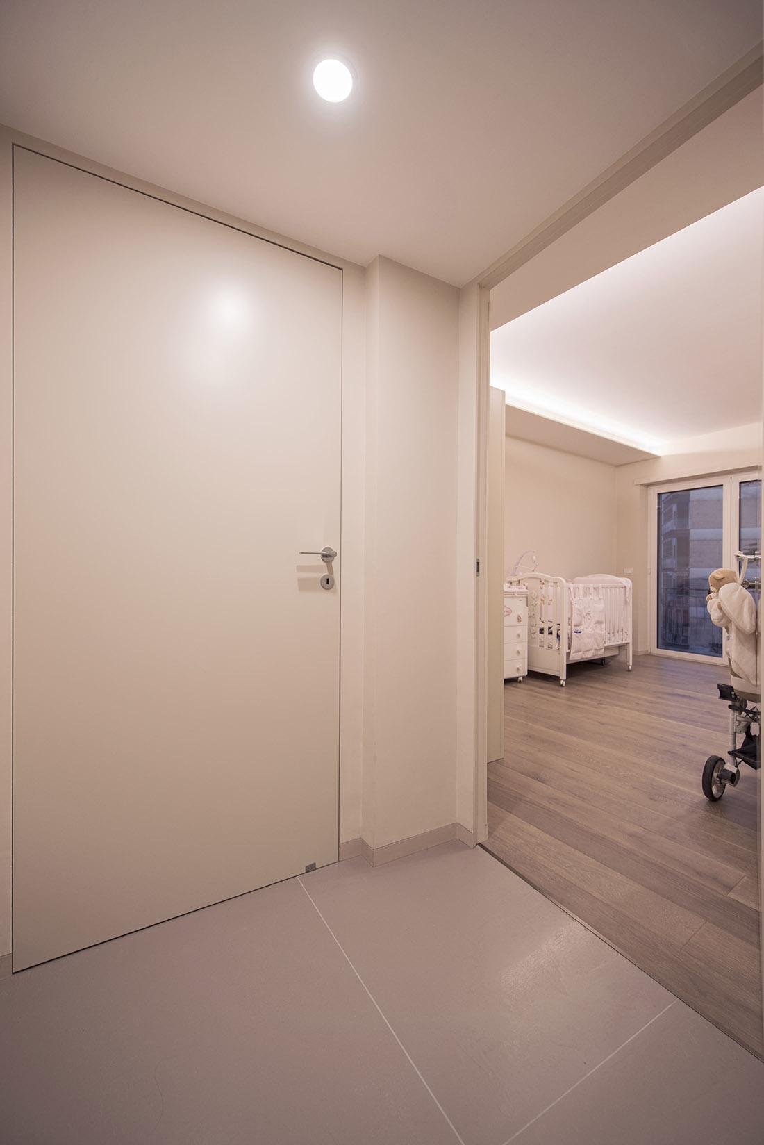 appartamento-otta2-porta-battiscopa-filomuro-cameretta-neonata-realizzazione-napoli-pucciarelli-architetti