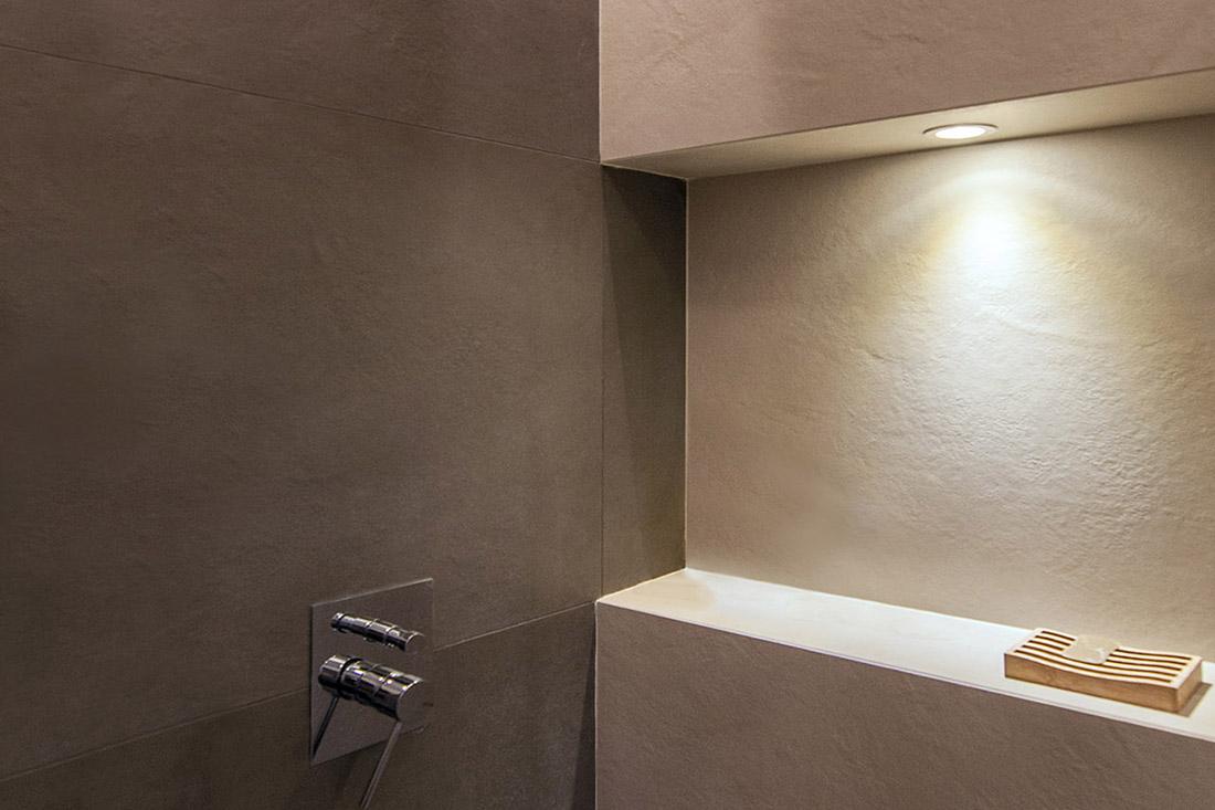 casa-tao-napoli-tufo-a-vista-recupero-moderno-pucciarelli-architetti-bagno-dettaglio-nicchia-doccia