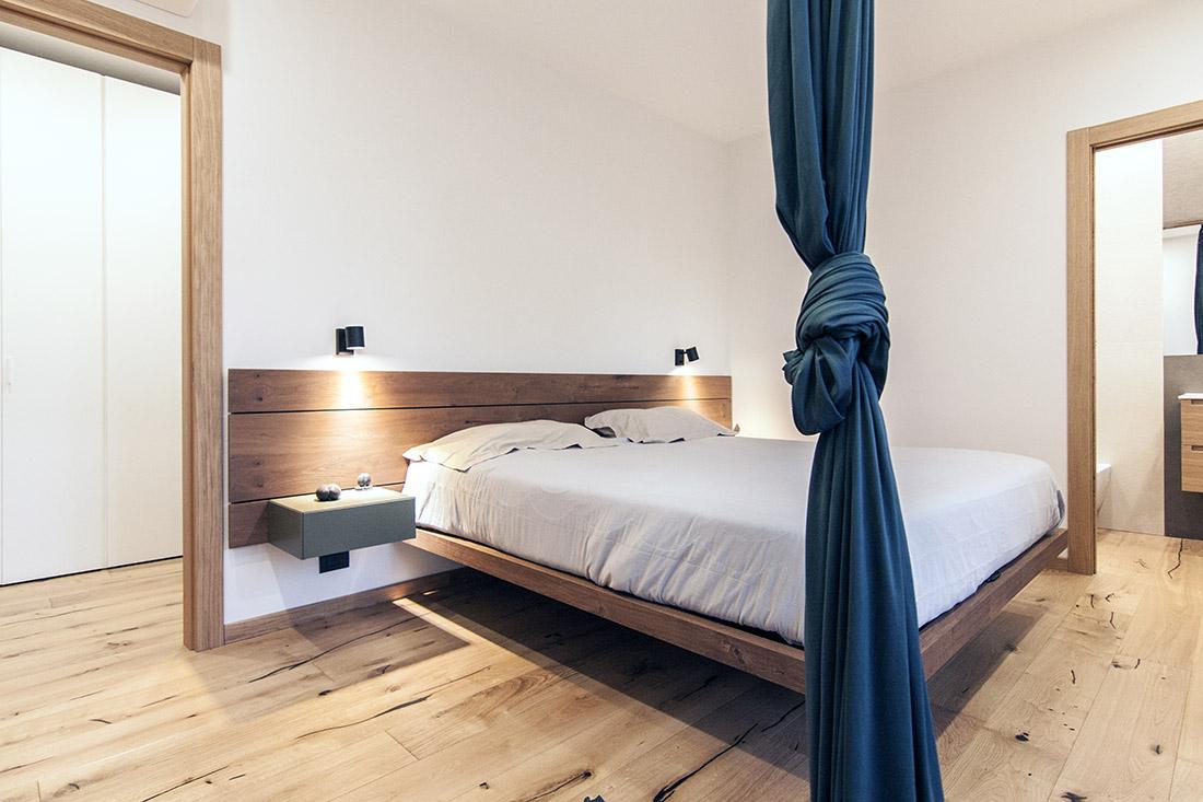 casa-tao-napoli-tufo-a-vista-recupero-moderno-pucciarelli-architetti-camera-tessuto